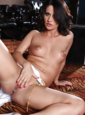 Elegant brunette whore Madlin rubs her gorgeous pussy and gets pleasure