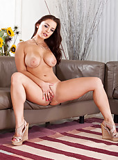 Pretty lady Liza Del Sierra undresses her sexy dress and demonstrates big tits