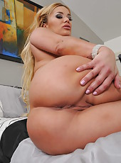 Sexy blonde babe Shyla Stylez undresses her sexy black skirt and gets pleasure