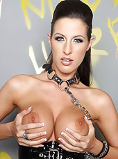 Hot and dangerous brunette Kortney Kane rubs her delicious boobs