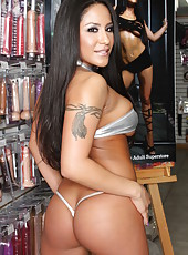 Jenaveve Jolie strips in the local store demonstrating her unforgettable forms
