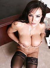 Pretty whore Lisa Ann takes a big dick and sucks it like a horny whore