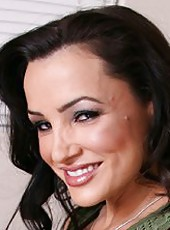 Brunette milf Lisa Ann undresses her clothes and puts on a great show