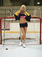 Mature blonde Puma Swede becomes wet and wild at the hockey rink