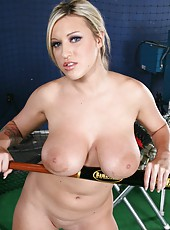 Memphis Monroe caresses her big tits and gentle pussy at the baseball training