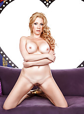 Busty blonde coquette Jennifer Best caresses her nipples and shaved pussy