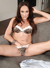 Lady with beautiful figure and sexy legs Michelle Lay poses without lingerie