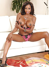 Chocolate skinned bombshell Diamond Jackson poses with her big tits