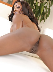 Chocolate skinned bombshell Diamond Jackson poses with her big tits