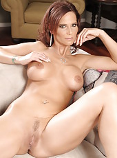 Mature bombshell with big tits and flawless skin Syren De Mer posing and stripping