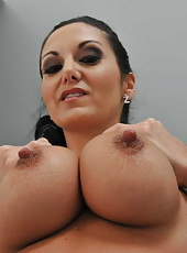 Glamorous brunette Ava Addams shows off her charms in sexy high heels