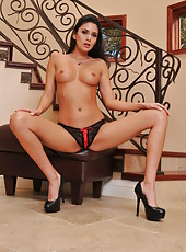 Long legged bewitching milf Nikki Daniels takes off sexy lingerie