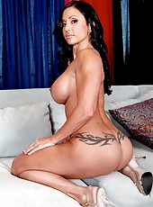 Muscled pornstar Jewels Jade demonstrates her big tits and poses in bikini