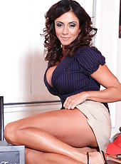 Charming pornstar Ariella Ferrera posing in panties and showing wet pussy