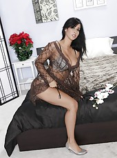 Tasty pornstar Isis Love posing in attractive lingerie and making pussy wet