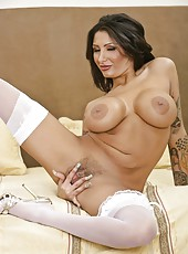 Tattooed milf Ricki Raxxx posing in white lingerie and having fun