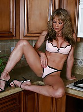 Petite pornstar Shayla Leveaux showing hot lingerie right in her kitchen