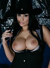 Lovely milf pornstar Sophia Lomeli stripping and rubbing yummy boobs