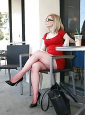 Nina Hartley is enjoying being filmed on camera in her red dress