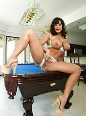 Sympathetic mature pornstar Lisa Ann posing at the pool and having fun