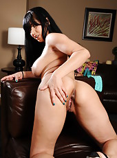 Nasty brunette bombshell Isis Love masturbates and rubs a wet clit