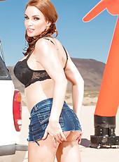Outdoor masturbation scene with a naughty redhead chick Diamond Foxxx