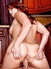 Playful redhead mommy Nicki Hunter gets a sperm on the big boobs