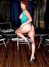 Dangerous redhead minx Nicki Hunter demonstrates her gorgeous body