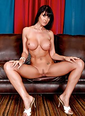 Elegant and tanned brunette chick Eva Karera demonstrates her secrets