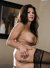 Seductive mature brunette Teri Weigel demonstrates her big naked secrets