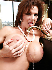 Famous mature minx Deauxma peels off her super hot red lingerie on the camera