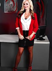 Busty milf Alena Croft elegantly peels off her black stockings on the table