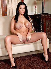 Astonishing black haired minx Sienna West plays with her delicious forms