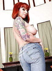Redhead with sexy tattoo Kylie Ireland takes off her clothes and lingerie