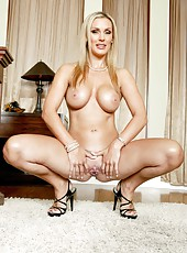 First-class blonde milf Tanya Tate shows her big tits and spreads long legs