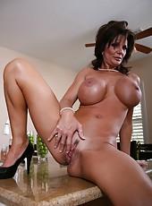 Horny brunette mommy named Deauxma demonstrates her huge boobs