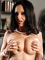 Voluptuous business woman Ava Adams poses with naked big natural boobs and shaved pussy