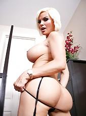 Marvellous blonde bombshell Diamond Foxxx takes off super hot corset and black stockings