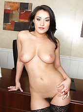 Black haired milf Charley Chase takes off her beautiful lingerie and remains in hot stockings