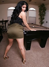 Black haired milf with huge ass and large tits Sophia Lomeli posing at the pool table