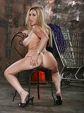 Sparkling milf Savannah Jane presents us inspiring strip show with her curvy body