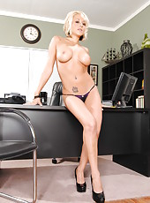 Briana Blair spends this hot lunch break demonstrating her big boobs on the table