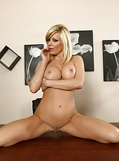 Elegant and glamorous mature bombshell Holly Sampson teases with her big tits and perfect snatch