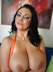 Fatty brunette milf in sexy high heels and skirt Angelica Sin shows off her big tits