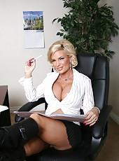 Elegant blonde milf Diamond Foxxx shows her gorgeous body in the office