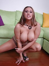 Delicious babe Alisandra Monroe undresses and demonstrates her big and hot tits