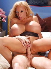 Mature blonde with unrealistically huge boobs fucking with mature skinny man