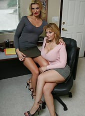 Excellent blonde business women Darryl Hanah and Sara Jay playing with their big boobs
