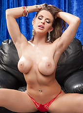 Glamorous lady Rachel RoXXX takes off her beautiful red lingerie and rubs shaved pussy