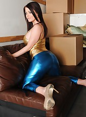 Busty babe Sophie Dee posing in latex clothes and fingering shaved pussy